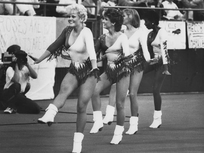 Indianapolis Colts cheerleader Michelle Bush, 19, of Shelbyville, Ind., leads the cheerleaders on the field during a Colts football game at the Hoosier Dome, date unknown.