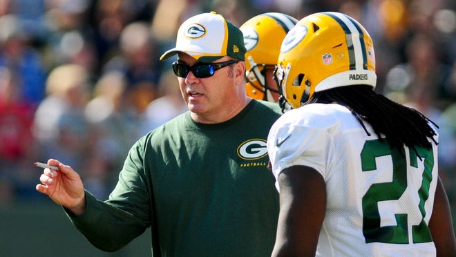 Green Bay Packers head coach Mike McCarthy gives instructions to running back Eddie Lacy during training camp practice at Ray Nitschke Field, Wednesday, July 30, 2014.