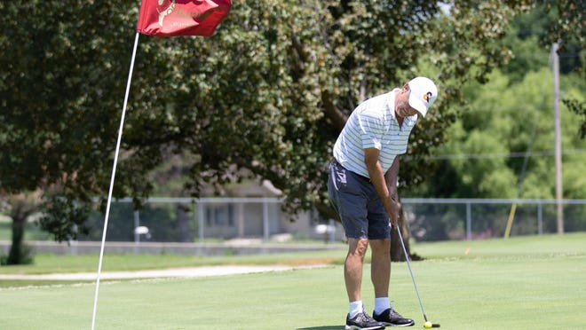 Gary Miles lines up his putt Thursday afternoon at the Shawnee Country Club during a round of golf. GreatLife Golf and Fitness at Shawnee Country Club will host the TeePAC Golf Tournament held by the Topeka Performing Arts Center on July 24.