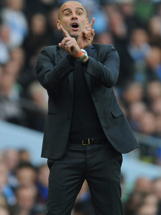 Manchester City manager Josep Guardiola gestures during the English Premier League soccer match between Manchester City and Everton at the Etihad Stadium in Manchester, England, Saturday, Oct. 15, 2016. (AP Photo/Rui Vieira)