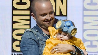 "Aaron Paul, with baby Story Annabelle dressed as his character Jess Pinkman, joins his ""Breaking Bad"" castmates at Comic-Con for a 10th-anniversary reunion."
