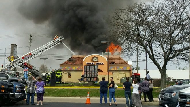 Crews respond to a fire at the Taco Bell restaurant located at 9067 Fields Ertel Road in Deerfield Township on Saturday.