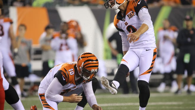 Cincinnati Bengals kicker Jake Elliott (3) kicks a point after touchdown in the third quarter during the Week 1 NFL preseason game between the Tampa Bay Buccaneers and the Cincinnati Bengals, Friday, Aug. 11, 2017, at Paul Brown Stadium in Cincinnati.