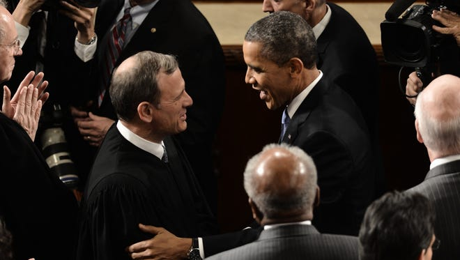 President Obama greets Supreme Court Chief Justice John Roberts prior to his State of the Union Address last year.