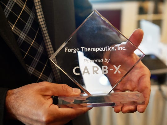Zachary Zimmerman shows off the CARB-X plaque recently