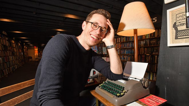 """Mike Gustafson and the Smith-Corona in his Ann Arbor bookstore, Literati Books, the source for """"Notes from a Public Typewriter."""""""