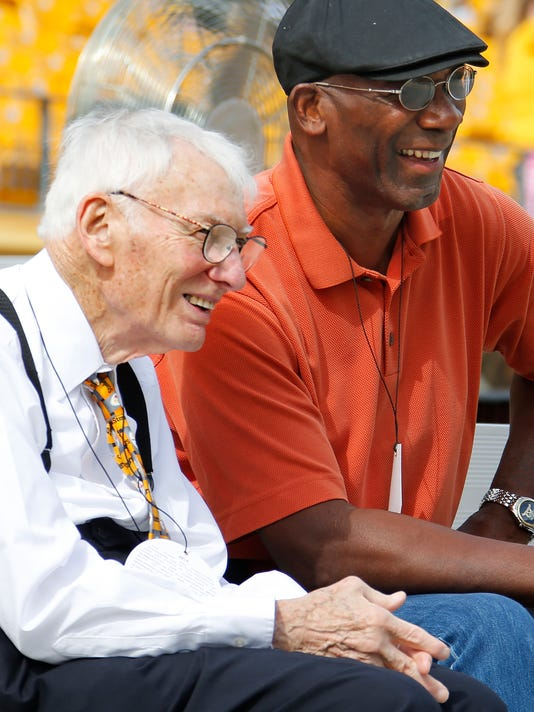 FILE--In this Sept. 28, 2014 photo former Pittsburgh Steelers wide receiver John Stallworth, left, talks with Steelers Chairman Dan Rooney before an NFL football game against the Tampa Bay Buccaneers in Pittsburgh. The Steelers announced that Mr. Rooney died Thursday, Apr. 13, 2017. He was 84. (AP Photo/Gene Puskar)