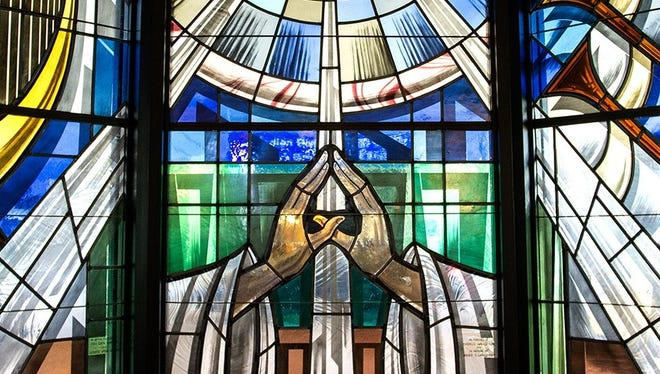The Post Chapel has 16 stained glass windows and 16 etched door panels created by the Conrad Pickel Studio in Vero Beach.