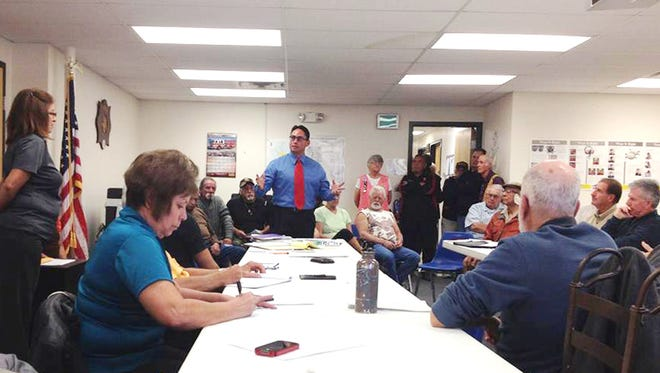 Sen. Howie Morales, center, speaks to New Mexico Senior Olympics board members about the behavior of the Grant County Senior Olympics board on Tuesday at the City Hall Annex.