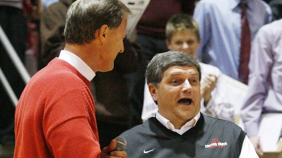 Athletic director Jon Zwitt congratulates Center Grove coach Cliff Hawkins celebrates who won his  his 400th game. Center Grove upset North Central in boys basketball at Center Grove Friday 2/19/10. Rob Goebel/Indianapolis Star. <b>12/30/2010 - M08 - JOHNSON - 1ST - THE INDIANAPOLIS STAR</b><br />Center Grove coach Cliff Hawkins says the Hall of Fame Class is the most prestisgious tournament in the state after the state tourbnament.