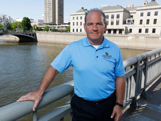 Cedar Rapids Mayor Ron Corbett stands on a bridge over