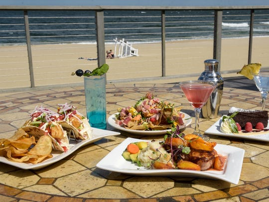 A selection of dishes from Mister C's Beach Bistro, which offers outdoor dining on the beach in Allenurst: Clockwise from left: fish tacos, ahi tuna nachos, chocolate mousse cake, and a grilled pork chop.