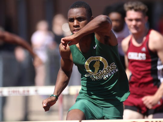 Lincoln senior Vincent Johnson races in the 110-meter