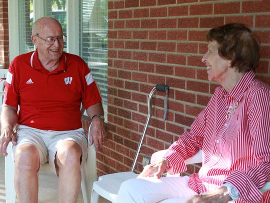 Doug Anderson and his wife Jean sit on their porch