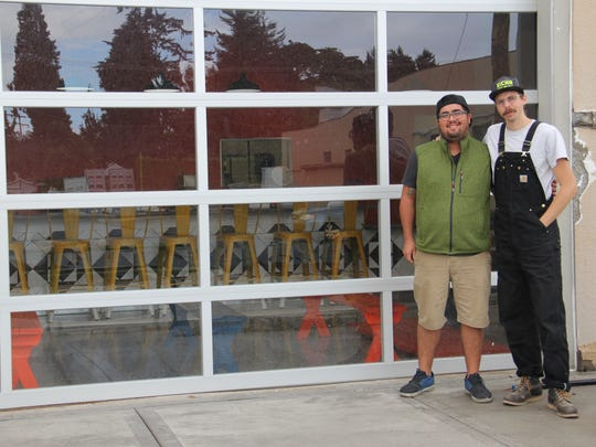 Ricardo Antunez and Matt Dakopolos stand outside their soon-to-open brewery, Xicha Brewing, in West Salem. Xicha is set to open this fall.