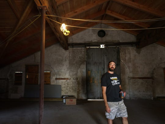 Craig Wensell walks through the site of Wilmington