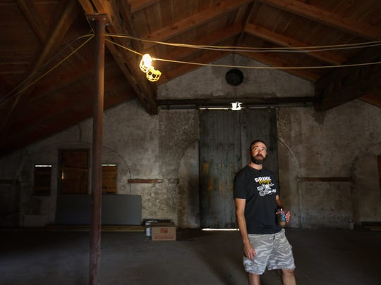 Craig Wensell walks through the site of Wilmington Brew Works on Wednesday. The production brewery is expected to open this spring.