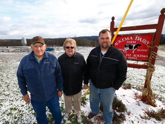 From left, Doug, Pat & Brian Aukema near where their