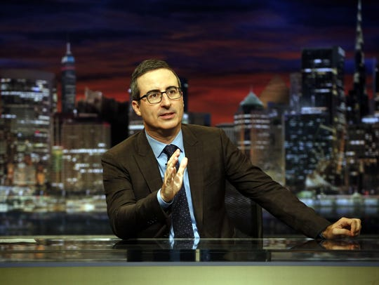 HBO's 'Last Week Tonight' host John Oliver. HBO is one of the plum assets that would come with Time Warner if AT&T succeeds in buying the entertainment juggernaut.