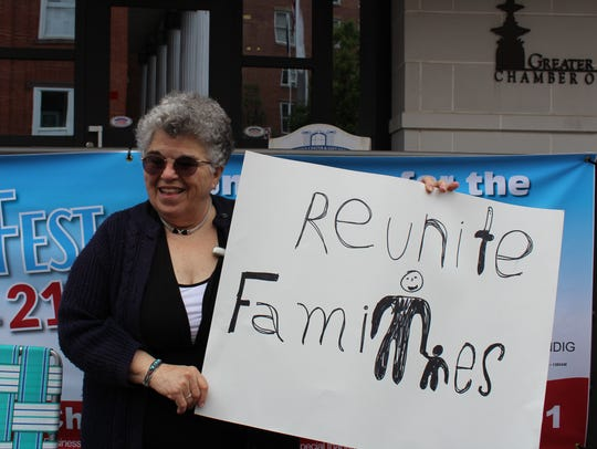 "Natalie Winter holds a sign during the ""Reunite Families"""