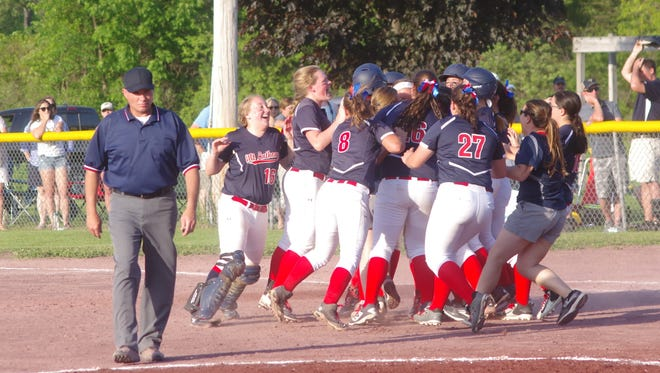 Mount Anthony celebrates its Division I high school softball title Saturday.