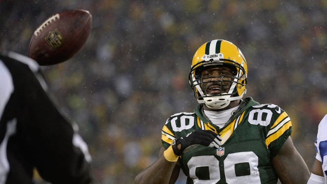 Green Bay Packers wide receiver James Jones (89) tosses the ball to the referee in the second quarter following a reception against the Dallas Cowboys.