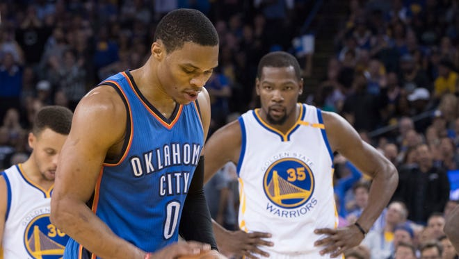 Kevin Durant out-scored Russell Westbrook 39-20 to lead the Warriors to a rout of the Thunder.
