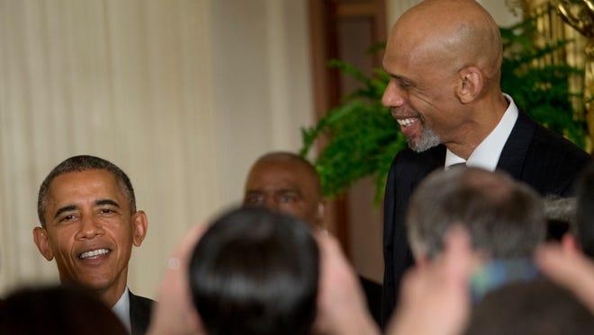 President Barack Obama and former NBA basketball player Kareem Abdul Jabbar talk in the East Room of the White House in Washington, Friday, Jan. 30, 2015. Photo: Pablo Martinez Monsivais, AP