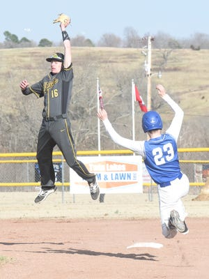 Salem shortstop Jake Hutson leaps to take a throw as Cotter's Hunter Grinder slides safely into second with a stolen base on Thursday at Warrior Field.