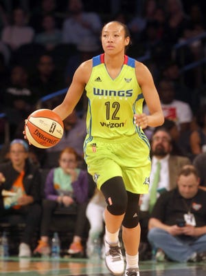 Ossining alumna Saniya Chong brings the ball up court during a WNBA game between the Dallas Wings and the New York Liberty at Madison Square Garden June 2, 2017.