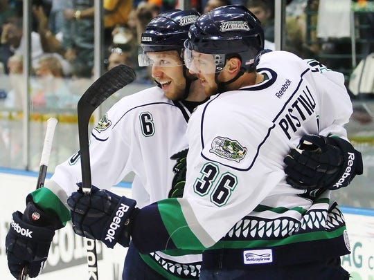 Florida Everblades' Tommi Kivisto, left, and Matthew Pistilli celebrate a goal against Reading during first-period play on April 26,  2013 at Germain Arena.
