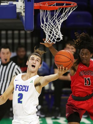 Florida Gulf Coast University's Caleb Catto scores against Southeastern University during play Thursday at Alico Arena in Fort Myers. FGCU beat Southeastern 81-54.