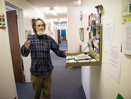 Dr. Robert Uhren walks through his office recently
