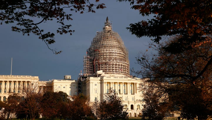 The U.S. Capitol Dome is seen under repair on Capitol