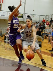 Freed-Hardeman's Brandee Busenlehner attempts to dribble past Bethel's Shamon Pearson during their game Tuesday evening at FHU.