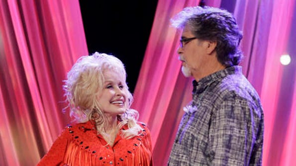 Dolly Parton talks with Randy Owen of the group Alabama