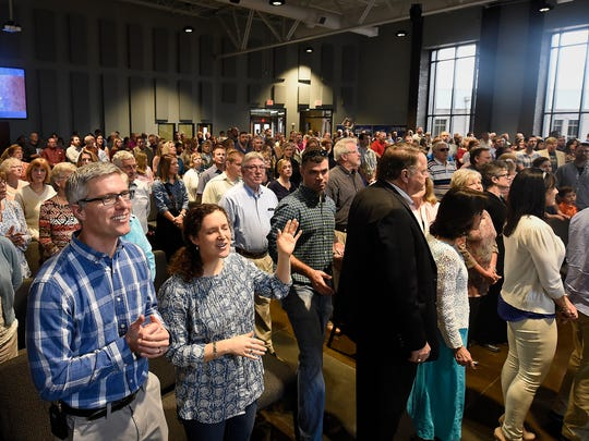 The Rev. Jacob Armstrong and his wife, Rachel, sing with the congregation on the first day of worship at the new Providence United Methodist Church building in Mt. Juliet.