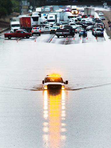 An emergency vehicle navigates through deep water as