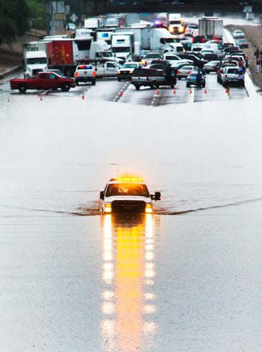An emergency vehicle navigates through deep water as