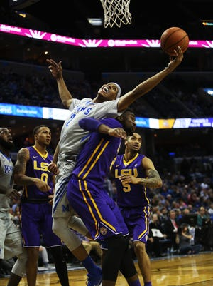 December 28, 2017 - Memphis Tigers forward/guard Jimario Rivers (2) grabs a rebound as he lands on the back of LSU forward Aaron Epps (21) during the second half at FedExForum on Thursday night in Memphis, TN. The Tigers lost to LSU 71-61.