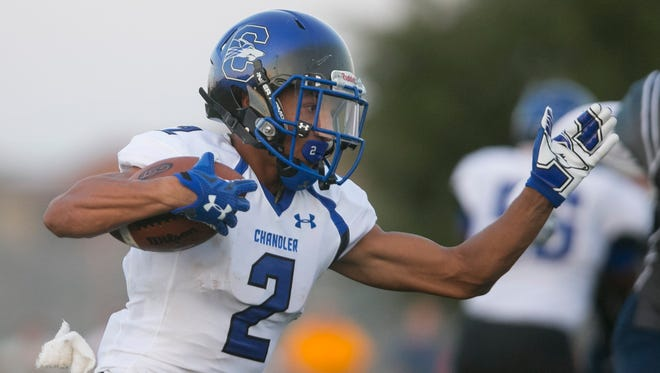 Chandler High's Chase Lucas runs for a touchdown on the first play from scrimmage against Pinnacle High at Pinnacle High School in Phoenix on Aug. 20, 2015.