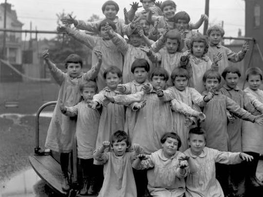Several children pose for a picture.