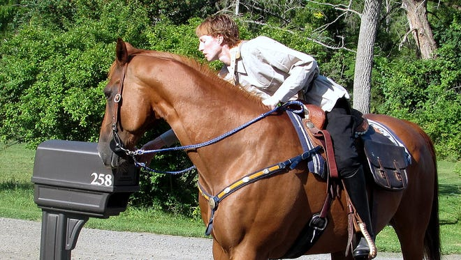 Letter carrier Amy Colussy delivers mail on horseback Tuesday to help the Horseheads Post Office celebrate its 190th birthday.