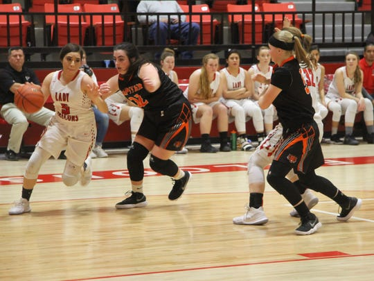 Junior Anyssa Rodriguez dribbles the ball toward the