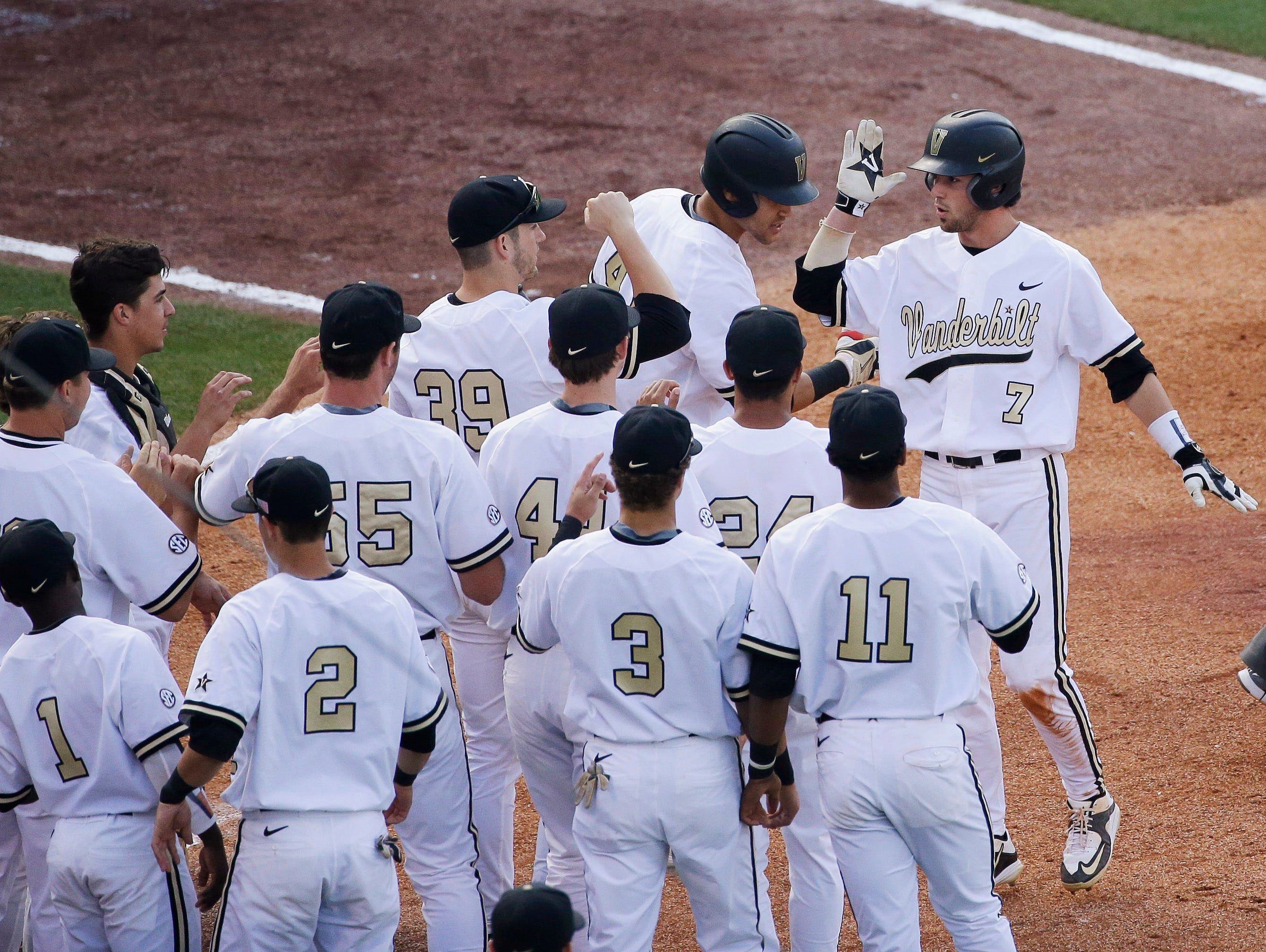 Vanderbilt's Dansby Swanson, right, has hit three homers in the SEC Tournament but the Commodores are hitting just .185.