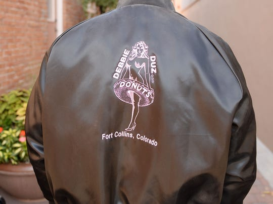 Dennis Cortese, opened topless doughnut shop Debbie Duz Donuts outside of Fort Collins in 1989, shows off his original Debbie Duz Donuts jacket.
