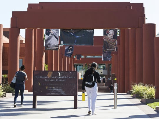 Students walk past the Harriet and Charles Luckman Fine Arts Complex at the The Cal State University, Los Angeles campus Thursday, April 25, 2019.