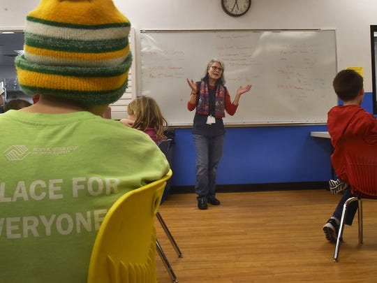 Susan Gigot-Klein, healthy lifestyles coordinator for the Boys & Girls Club of Door County, talks to the young diners at its facility in Sturgeon Bay on Monday, Feb. 12, 2018. The club has launched a dinner program three nights a week.