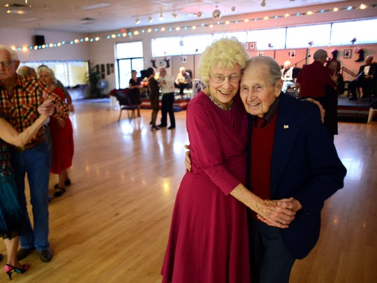 Jerry Perry dances with his wife, Joan, at the Keizer/Salem Area Senior Center on Friday, Jan. 9, 2015, in Keizer. Perry turned 100 on Jan. 11.