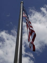 Acuity's record-breaking flagpole was dedicated Monday